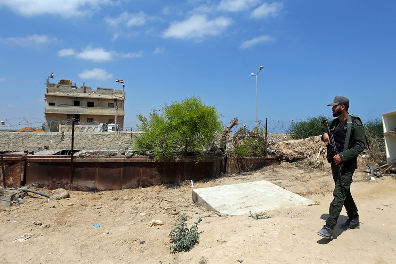 Member of Palestinian security forces loyal to Hamas patrols the border area with Egypt, in the southern Gaza Strip