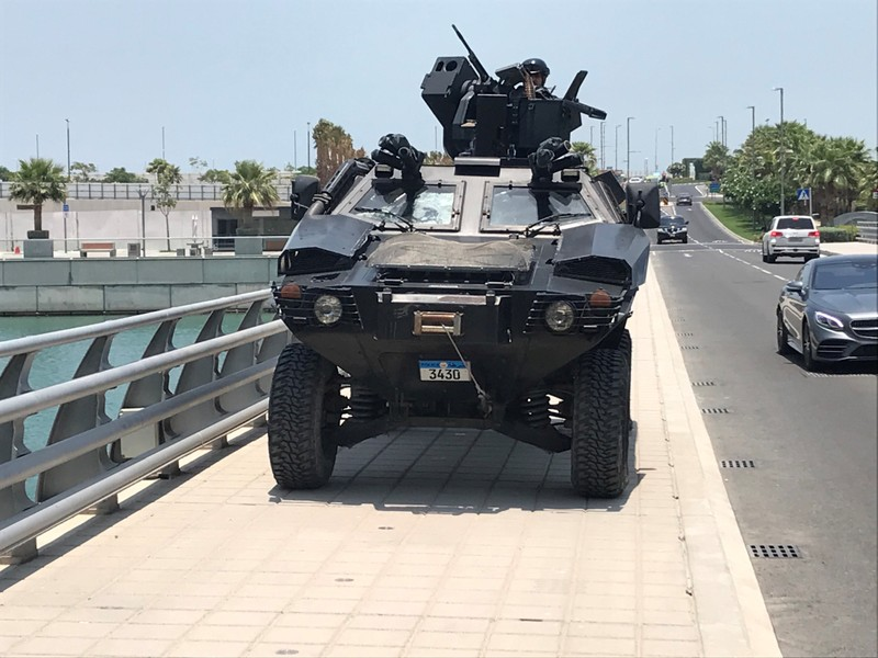 """Bahraini armoured vehicle takes up position on bridge leading to Manama's Four Seasons hotel for first day of U.S.-hosted """"Peace to Prosperity"""" conference, in Manama"""