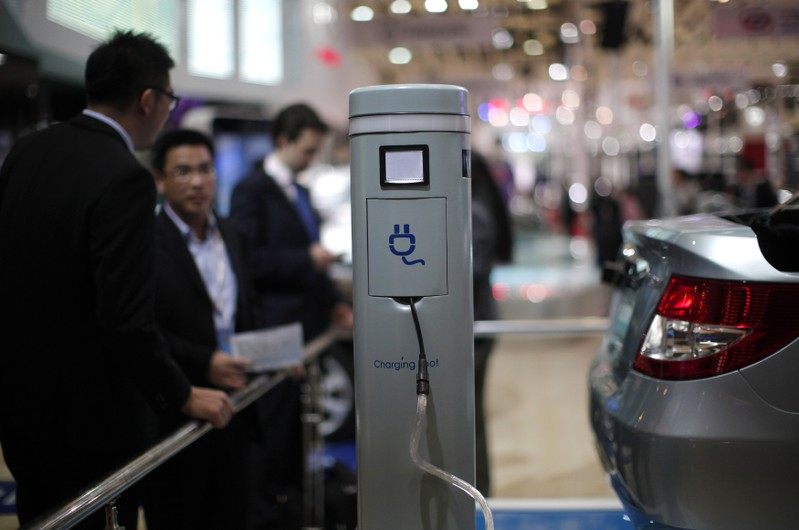 FILE PHOTO: A charging spot is seen at the stage of Chinese automaker BYD during the opening day of the Shanghai Auto Show