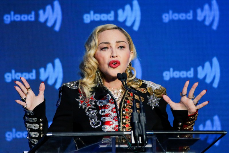 Madonna defends 'disturbing' gun massacre video