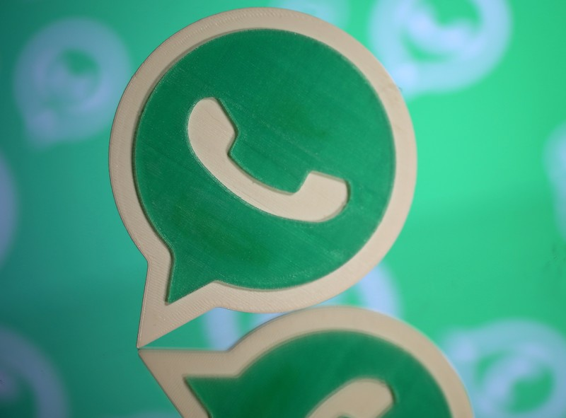 FILE PHOTO: A 3D printed Whatsapp logo is seen in front of a displayed Whatsapp logo in this illustration