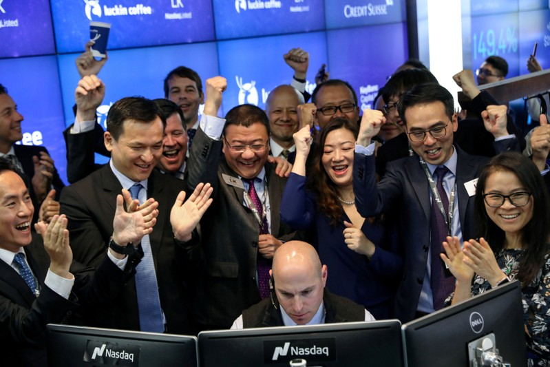 FILE PHOTO: Jenny Qian Zhiya CEO of Luckin Coffee celebrates the company's stock trading during the IPO at the Nasdaq Market site in New York