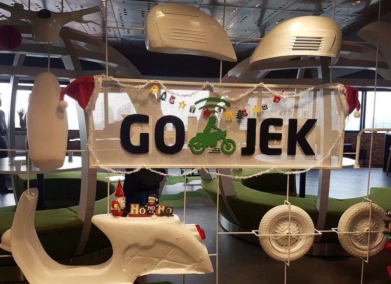 A Go-Jek logo is pictured in their office in Singapore