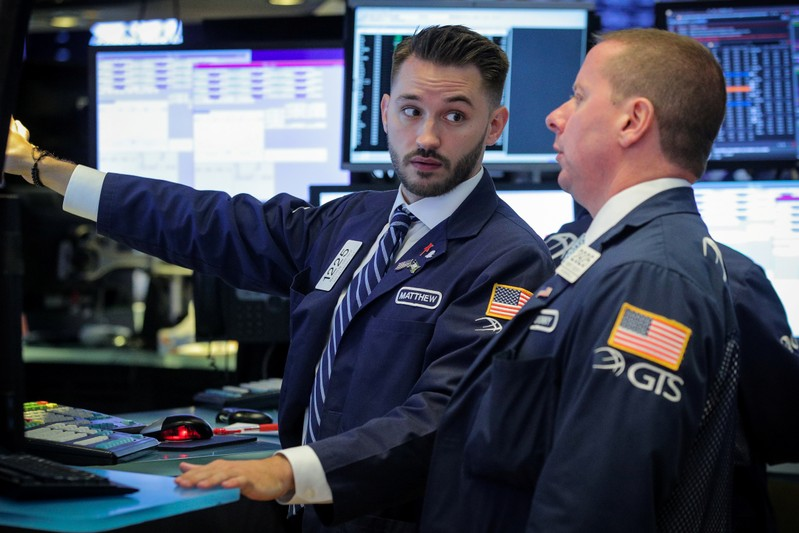 Traders work on the ground at the NYSE in New York