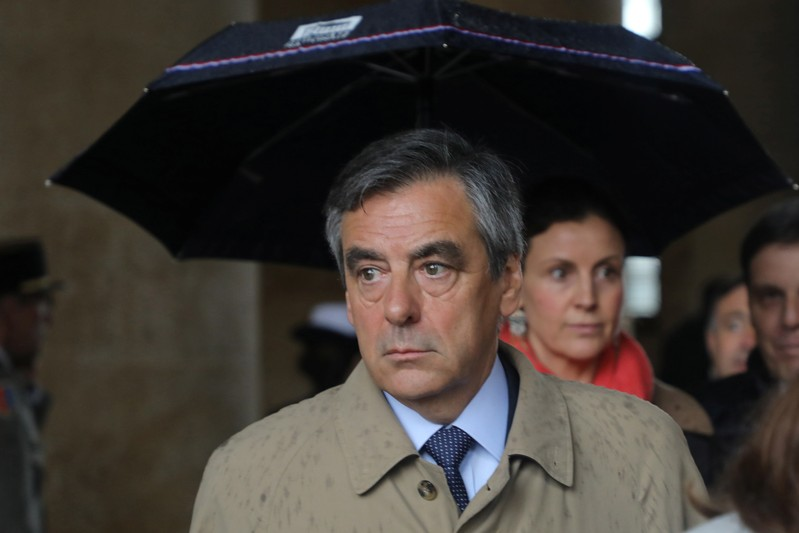 Former French Prime Minister Francois Fillon leaves after a national ceremony for late Lieutenant-Colonel Arnaud Beltrame at the Hotel des Invalides in Paris
