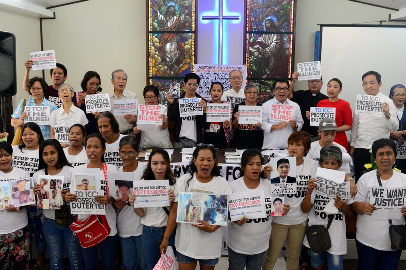 FILE PHOTO: Activists and families of drug war victims display placards during a protest against the war on drugs by President Rodrigo Duterte in Quezon city
