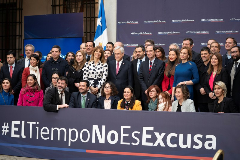 Chilean President Sebastian Pinera poses for a picture after signing a bill that removes the statute of limitations on sex crimes involving children, at the government house in Santiago