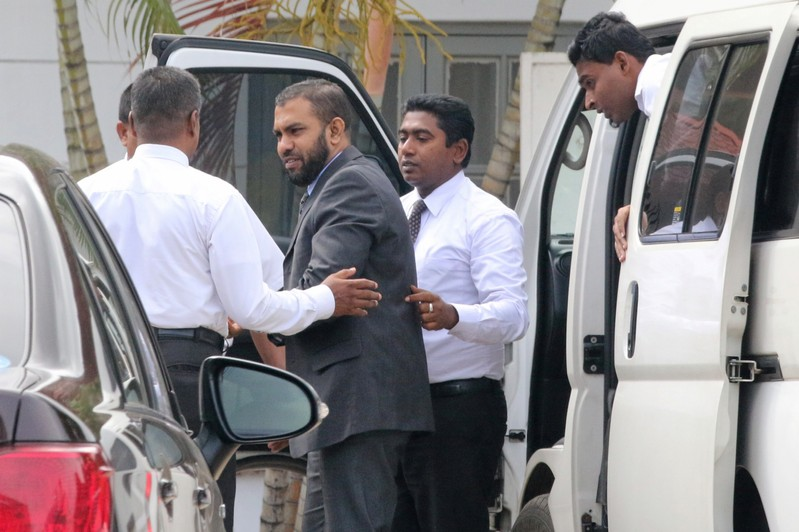 Muslim doctor Segu Shihabdeen Mohamed Shafi is escorted by Criminal Investigation Department officials at the Magistrate Court in Kurunegala