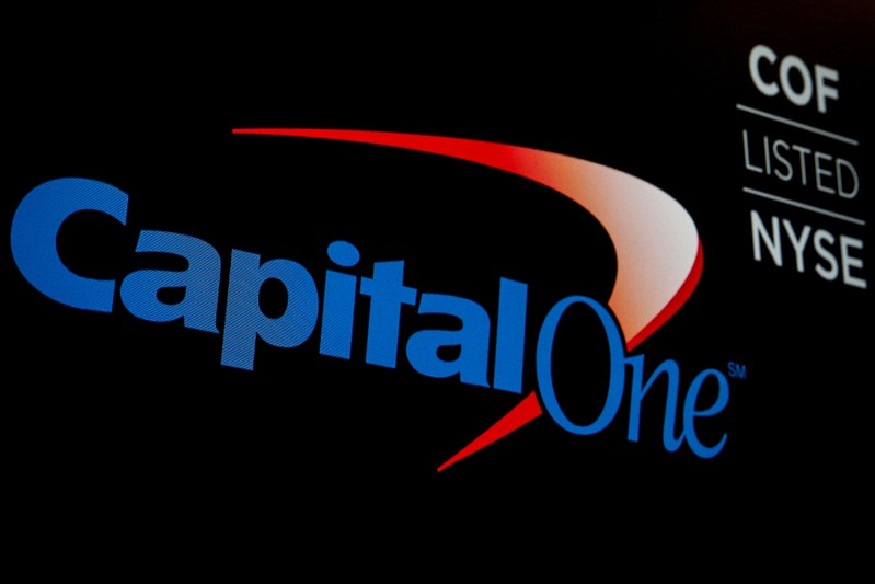 FILE PHOTO: The Capital One logo and ticker appear on a NYSE New York floor screen