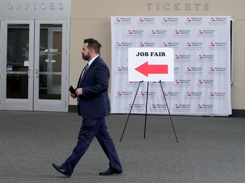 FILE PHOTO: A man walks into register at a job fair in Sandy, Utah