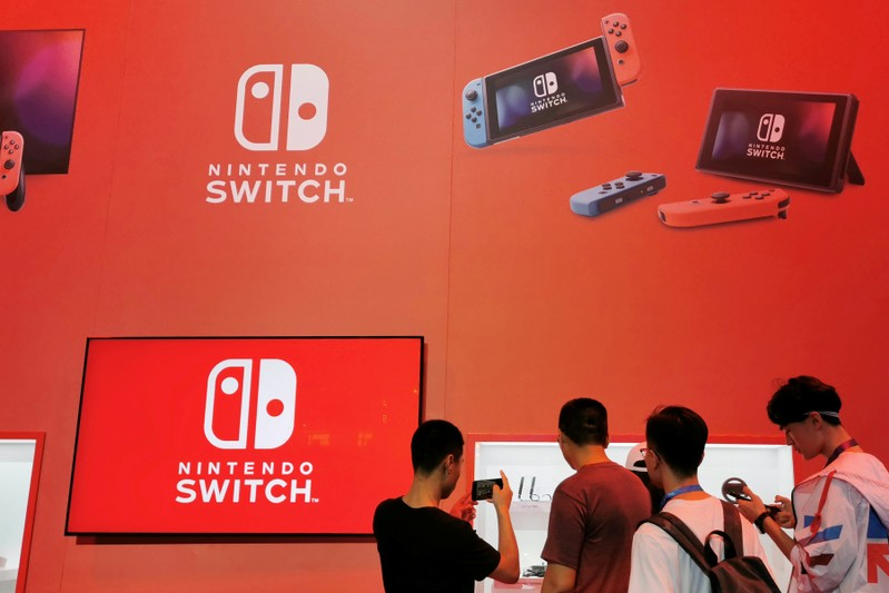 Visitors are seen at a booth of Nintendo Switch at the China Digital Entertainment Expo and Conference, also known as ChinaJoy, in Shanghai