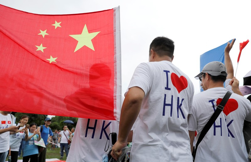 Pro-government supporters attend a rally to support the police and call for an end to violence in Hong Kong