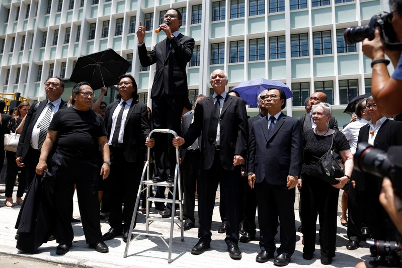 Lawyers and workers in Hong Kong's legal sector gather outside the Department of Justice during a protest in Hong Kong