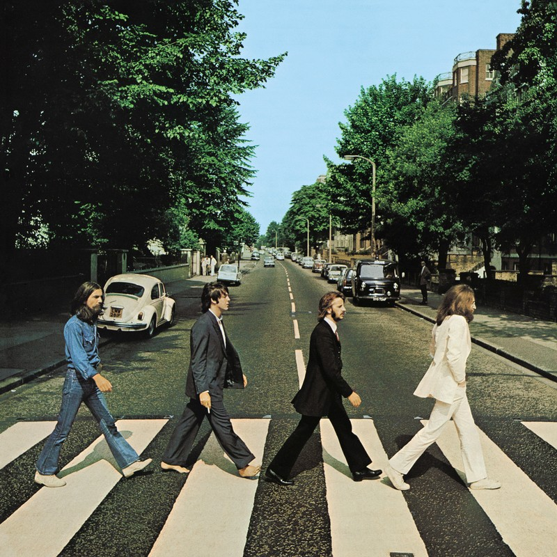 Members of the Beatles cross Abbey Road in London