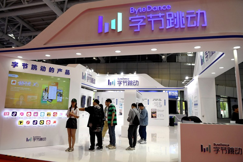 People are seen at the Bytedance Technology booth at the Digital China exhibition in Fuzhou, Fujian