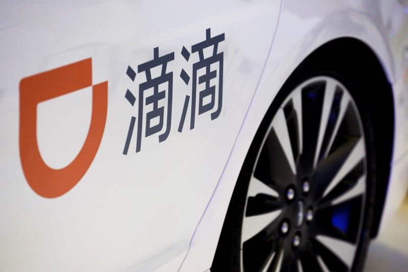 FILE PHOTO: The company logo of ride hailing company Didi Chuxing is seen on a car door at the IEEV New Energy Vehicles Exhibition in Beijing