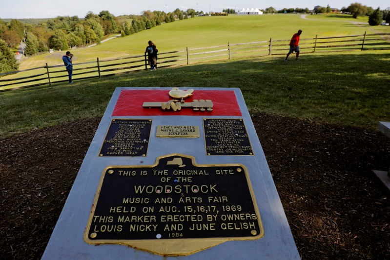 FILE PHOTO: A memorial stands above the original site of the Woodstock Music Festival while visiting to celebrate the 50th anniversary of the infamous Woodstock Music Festival in Bethel, New York