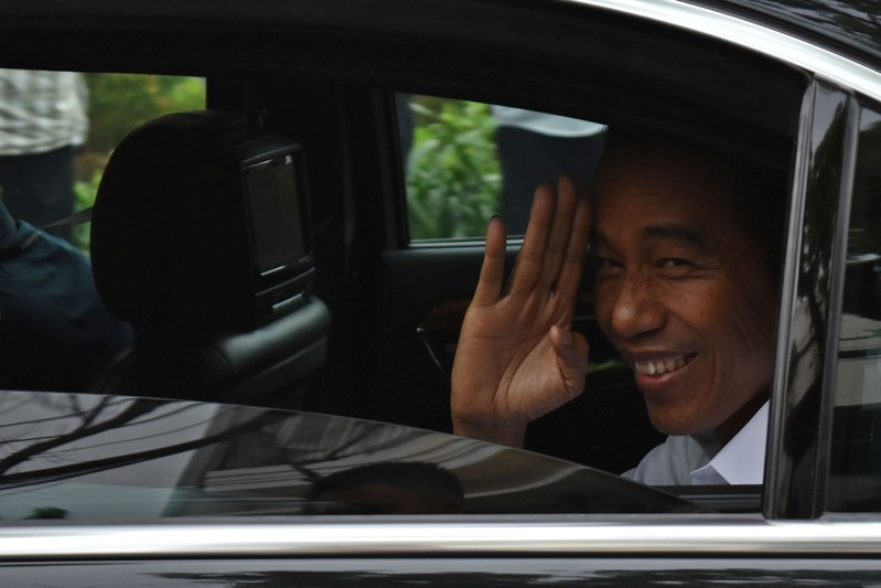 FILE PHOTO: Incumbent Indonesian president Joko Widodo leaves after a press briefing in Jakarta