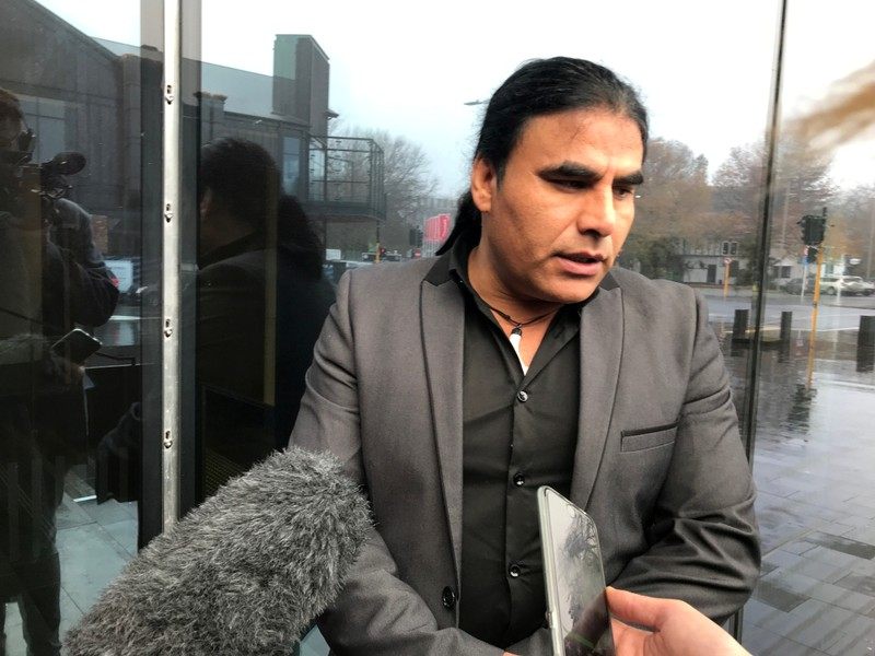 FILE PHOTO: Abdul Aziz, who chased away gunman Brenton Tarrant with an Eftpos machine at Linwood mosque on March 15, speaks to journalists outside the Christchurch High Court in Christchurch