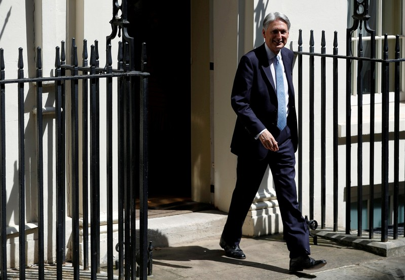 FILE PHOTO: Chancellor of the Exchequer Philip Hammond leaves Downing Street in London
