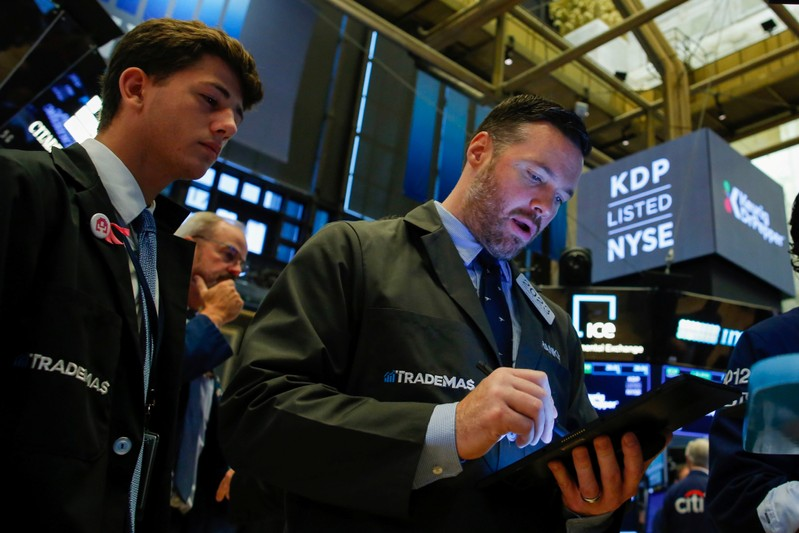 Traders working on the New York Stock Exchange (NYSE) floor in New York