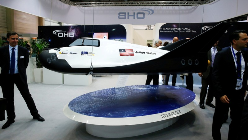 FILE PHOTO: Visitors watch the Dream Chaser Cargo System developed by Sierra Nevada Corporation Space Systems at the ILA Berlin Air Show in Schoenefeld