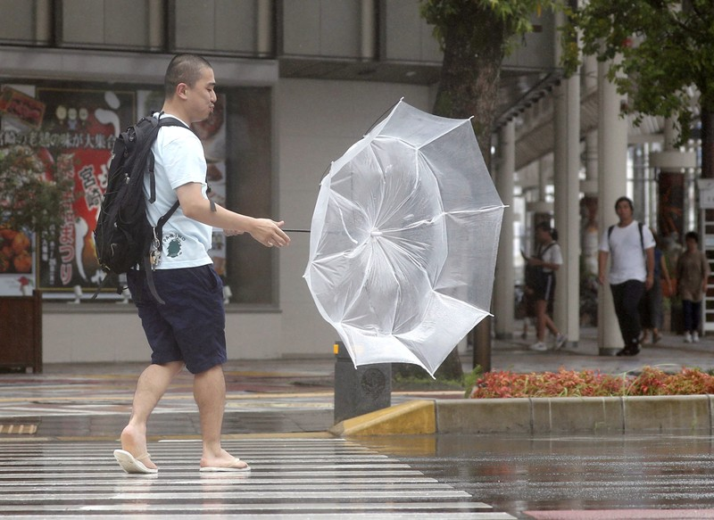 A man makes his way amid strong wind by typhoon Krosa in Miyazaki