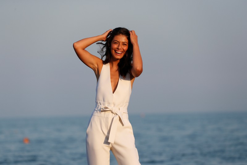 Italian actress Alessandra Mastronardi poses during a photocall on the beach