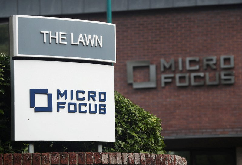 FILE PHOTO: Signs outside the offices of British IT company Micro Focus International