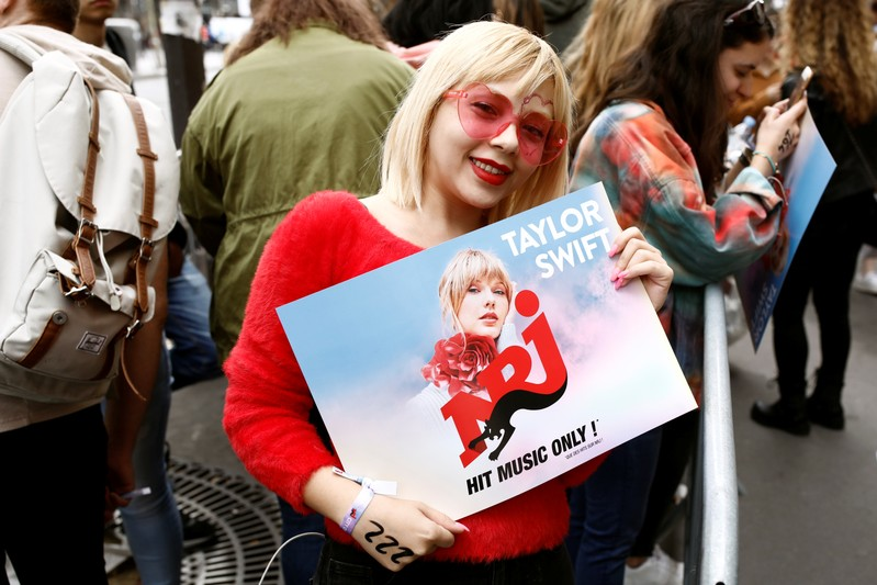 Fans of Taylor Swift wait in line to enter the Olympia Theatre prior to her concert performance in Paris