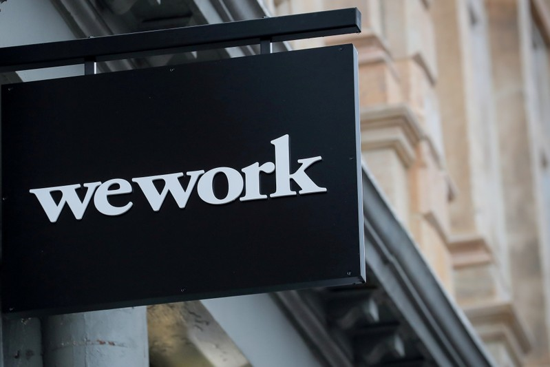 FILE PHOTO: The WeWork logo is displayed outside of a co-working space in New York