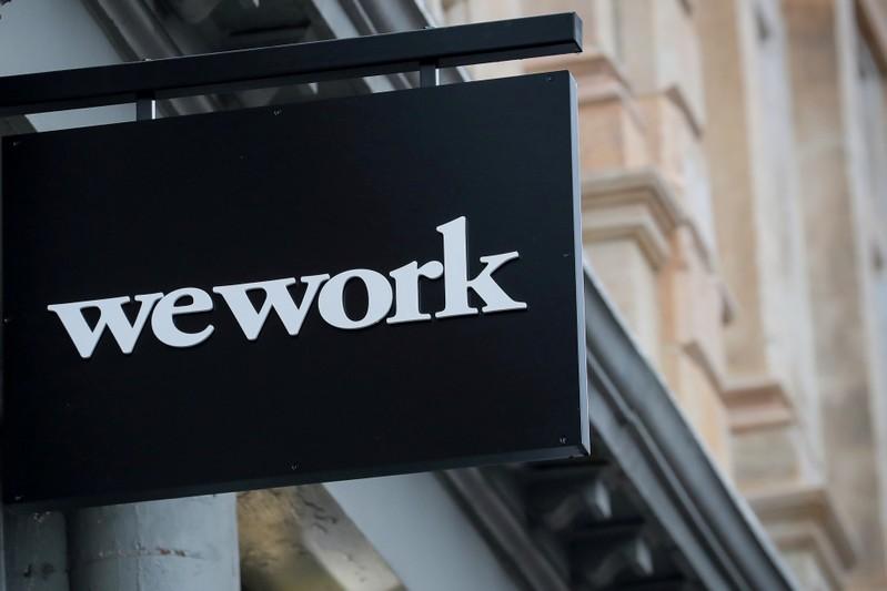 SoftBank urges WeWork to shelve IPO