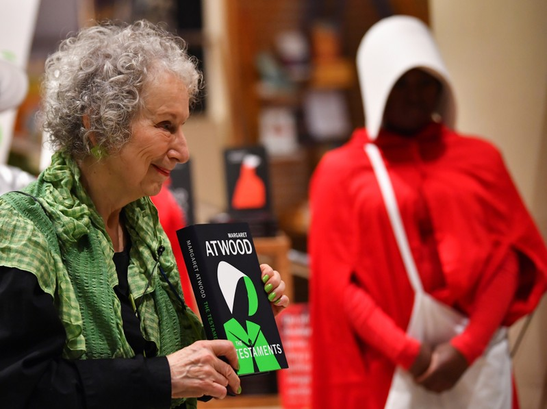Author Margaret Atwood holds up her new novel The Testaments during the launch at a book store in London, Britain