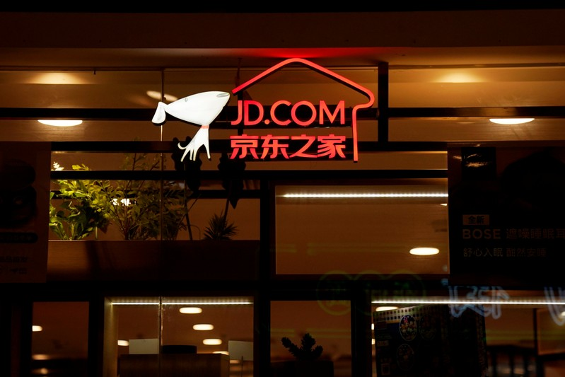 FILE PHOTO: A sign of China's e-commerce company JD.com is seen at its shop at a mall in Shanghai