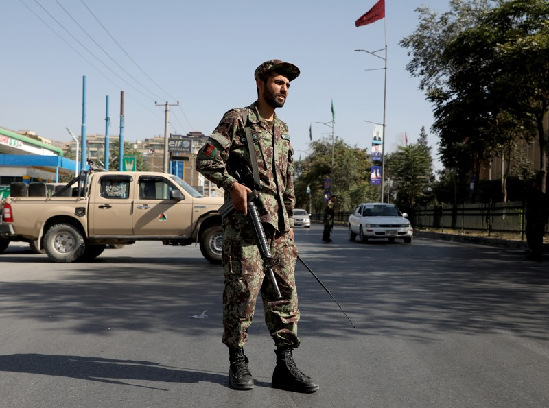 An Afghan National Army (ANA) soldier stands guard at a check point in Kabul, Afghanistan
