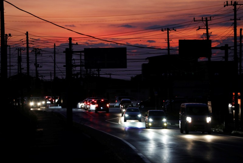 Cars drive past during a blackout caused by Typhoon Faxai in Kisarazu, Chiba prefecture