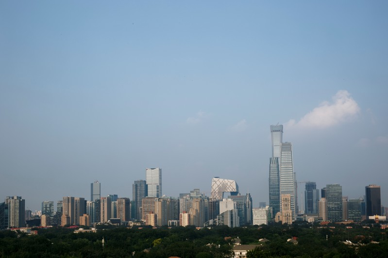 The skyscrapers of the Central Business District rise behind the capital's embassy neighbourhood in Beijing