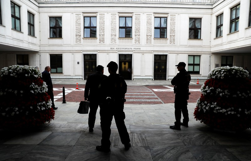 Security guards of Parliament stands outside the building of Parliament in Warsaw