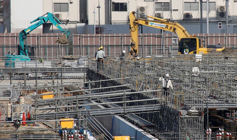 Power shovel machines are seen at a construction site in Tokyo