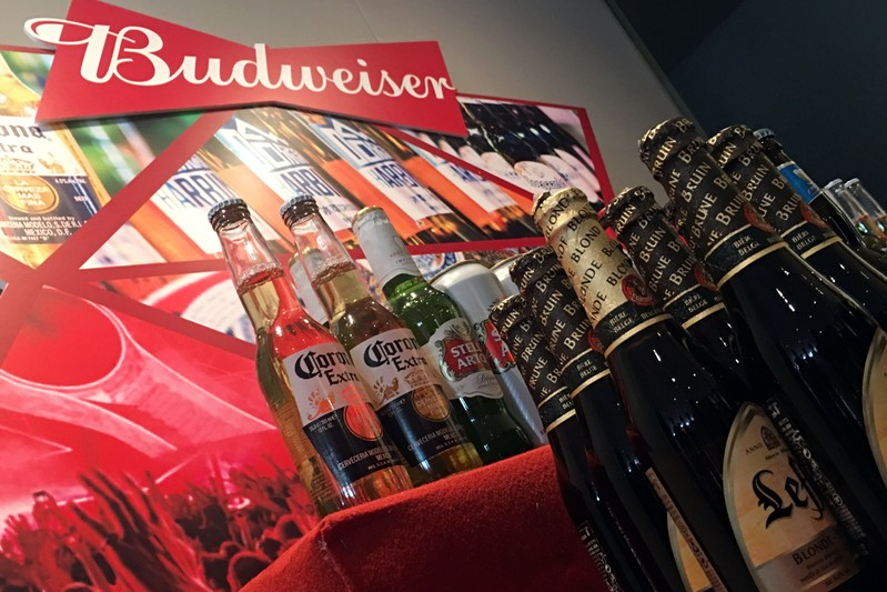 Portfolio beer brands of Budweiser Brewing Company APAC Ltd are displayed during a news conference on the company's IPO in Hong Kong