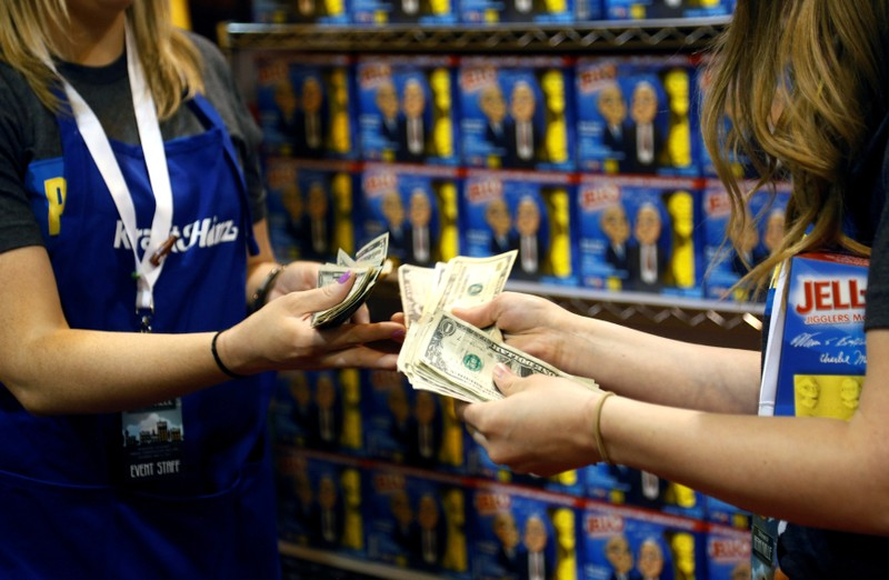 Kraft Heinz booth count money at the shareholder shopping day in Omaha