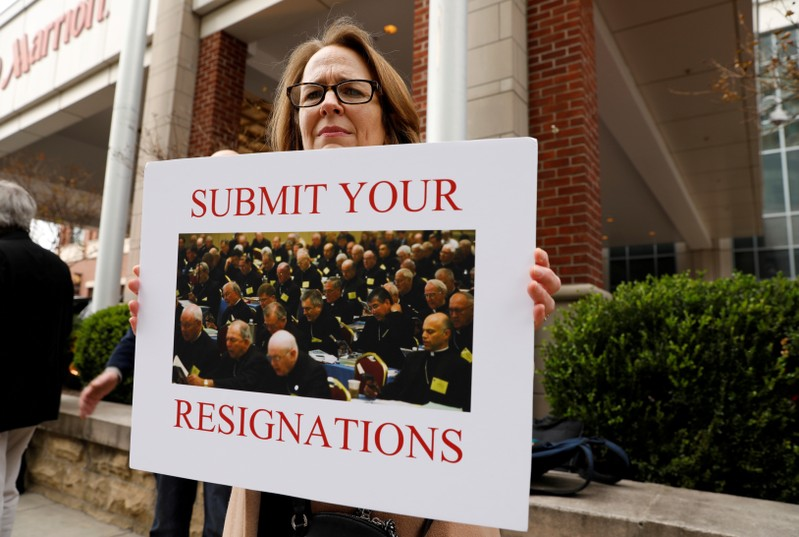 FILE PHOTO: Anne Barrett Doyle, co-director of BishopAccountability.org, holds a sign during the protest outside the venue of the United States Conference of Catholic Bishops (USCCB) general assembly in Baltimore