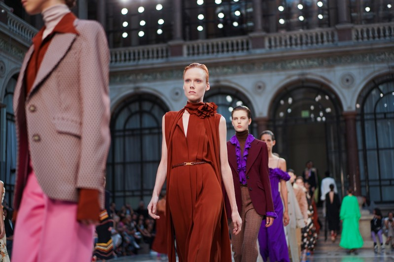 Models present creations during the Victoria Beckham catwalk show at London Fashion Week in London