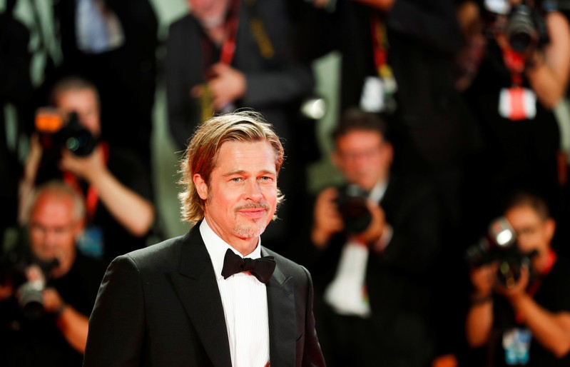 Brad Pitt asks astronaut: Who was more believable - George Clooney or me?