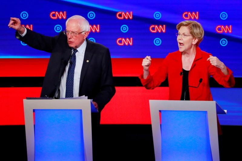 FILE PHOTO: U.S. Senators Sanders and Warren speak on the first night of the second 2020 Democratic U.S. presidential debate in Detroit, Michigan