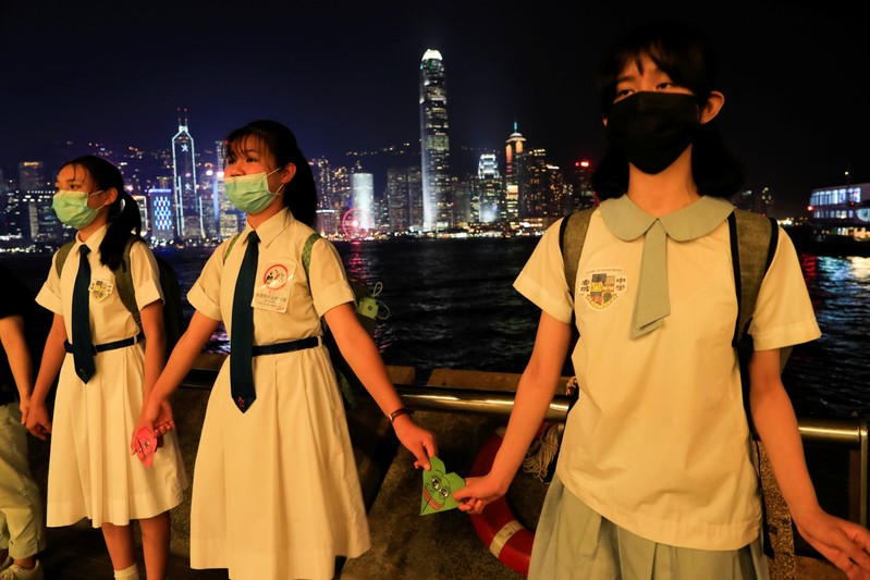 Anti-government protesters make a human chain in the harbour area in Hong Kong