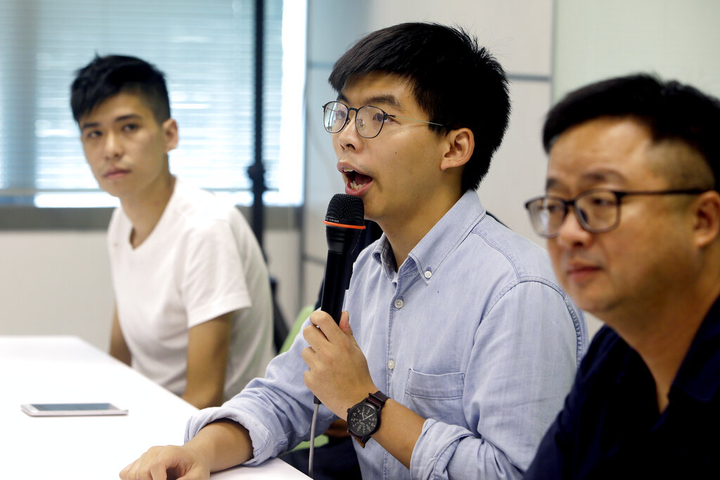 Hong Kong tells U.S.  to stay out; students form protest chains