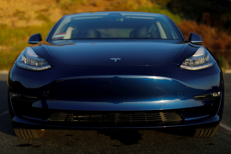 FILE PHOTO: A 2018 Tesla Model 3 electric vehicle is shown in Cardiff, California,
