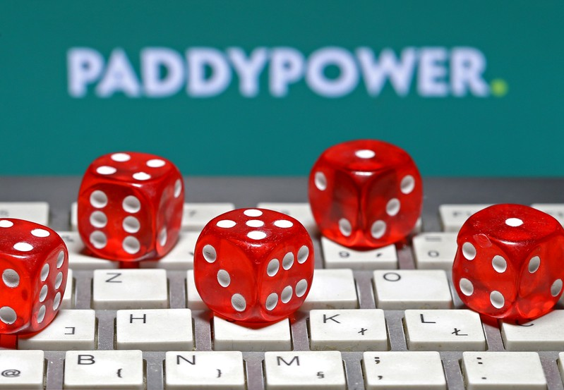 FILE PHOTO: Paddy Power logo is seen behind a keyboard and gambling dice in this illustration taken in Sarajevo