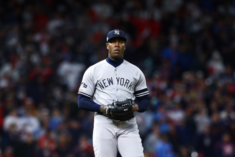 Bottle hurts Yankees' Aroldis Chapman's hand during celebration